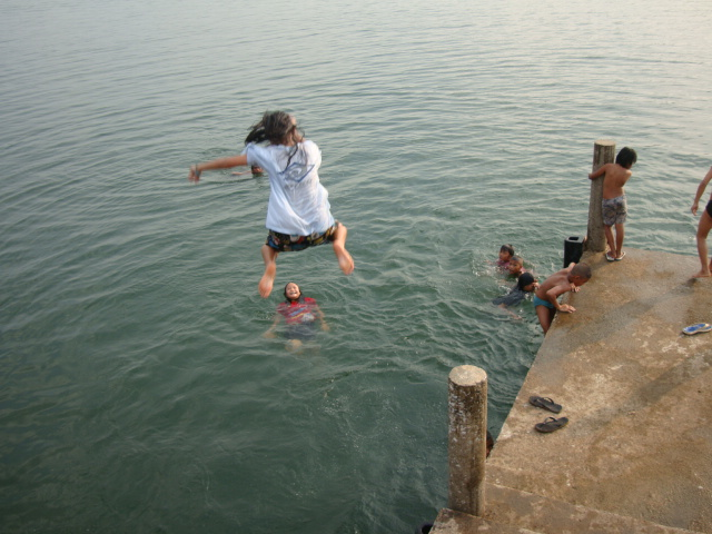 Picture: one of Naam's kids gets some air before hitting the water.  Sangkhlaburi, Thailand