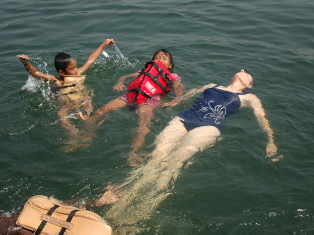 Picture: Ruth floats with the kids. Sangkhlaburi, Thailand