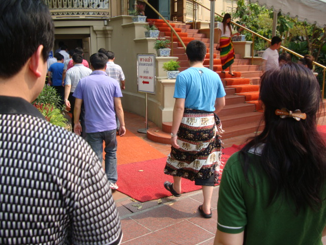 Picture: a visitor from China made respectable by wearing a Burmese style wrap over his shorts. Bangkok, Thailand