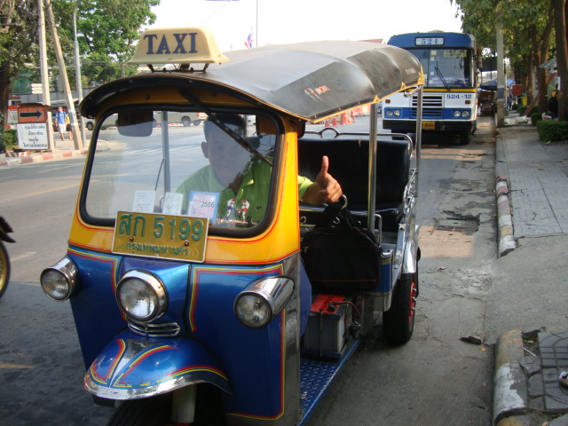 Picture:  Our tuktuk driver was all smiles and no hard feelings after his failed attempt to rob us.  Bangkok, China