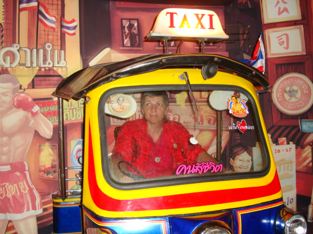 Picture:  Ruth plays tuktuk driver in the Siam Museum of Discovery, Bangkok, Thailand