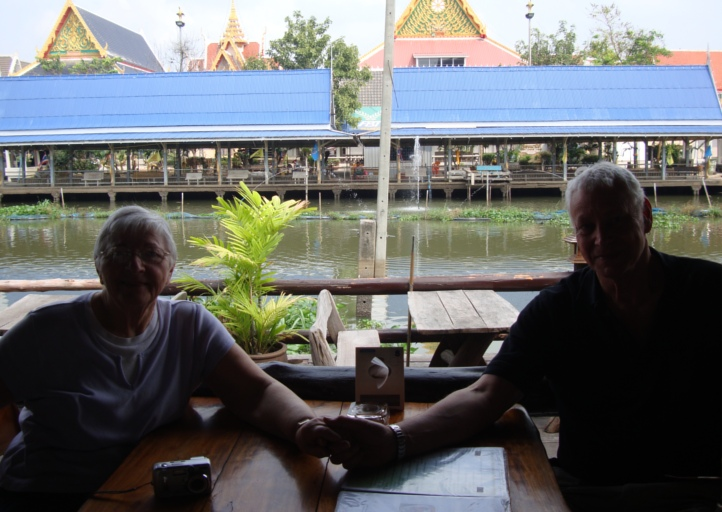 Bascklit Picture: Pat and David waiting for lunch at a restaurant by the river in Bangkok.