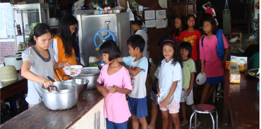 Picture:  Naam's kids line up for dinner at Baan Maa Naam, Mother Naam's House