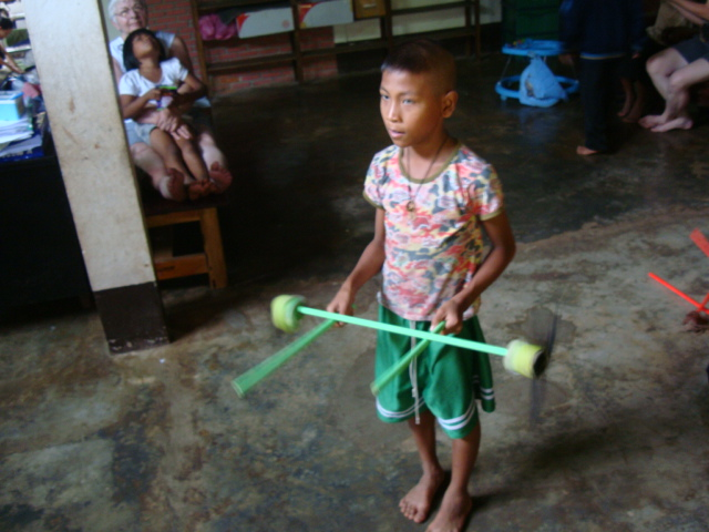 Picture: One of Naam's boys tries out the crystal sticks.  Baan Maa Naam, Sangkhlaburi, Thailand