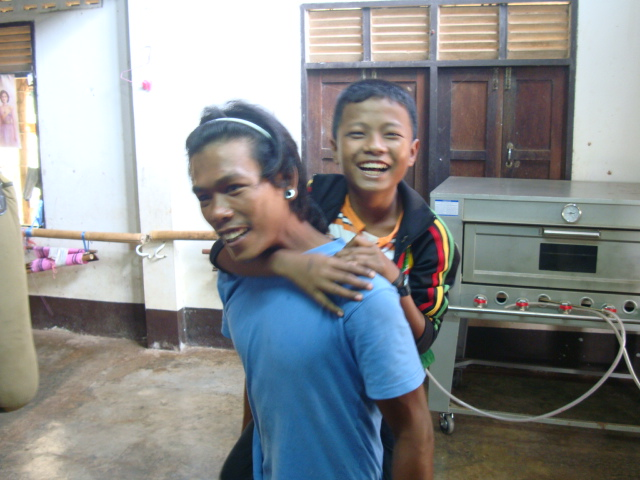 Picture: one of Naam's kids expresses his affection for the house father.