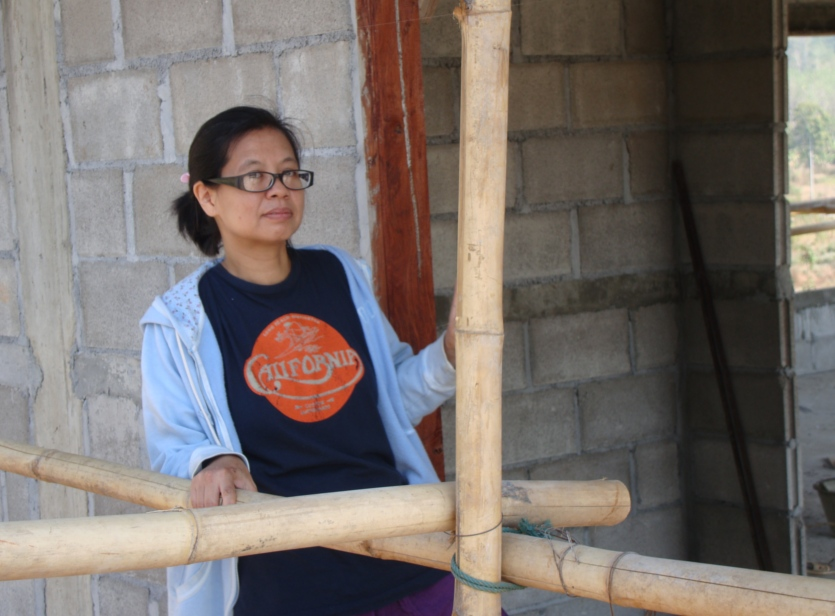 Picture: Naam on an inspection tour of the new home for her children, under construction near Sangkhlaburi, Thailand.