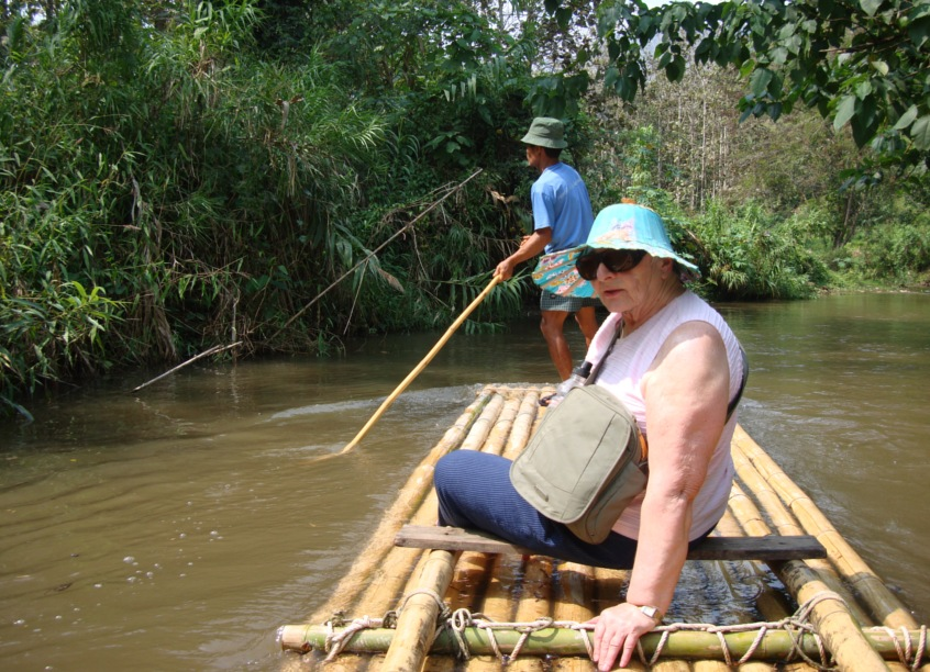 Picture: Pat on the bamboo raft, not please by being asked to turn for the camera.  She splashed me.