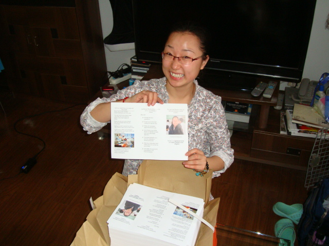 Picture: Panda opens 1000 copies of her brochure, which looks very good if I do say so myself.  Jiangnan University, Wuxi, China