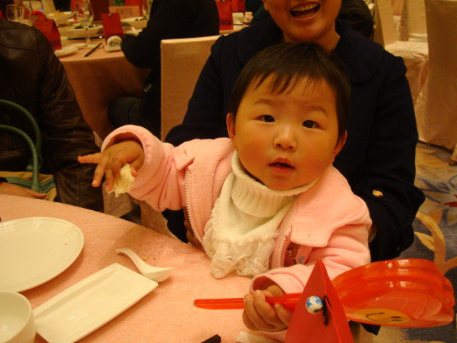 Picture: And the youngest of the guests at the wedding.  Wuxi, China