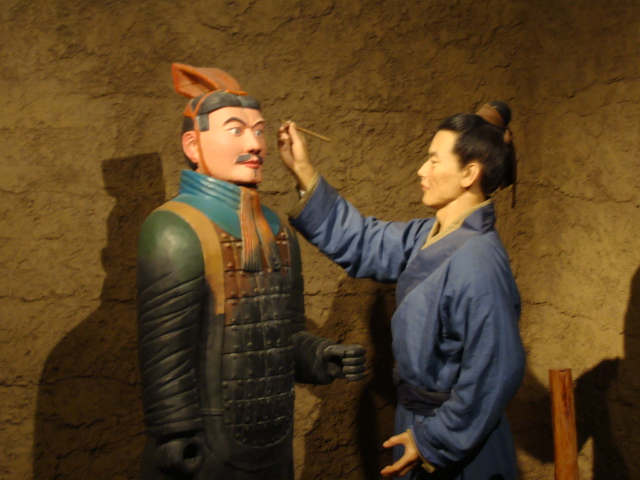 Picture: In the Wuxi clay figure museum.  A clay figure painting a clay figure.  Very meta.  Wuxi, China