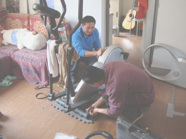 Picture:  Two repair men, one machine, more than an hour at work, all for $19.44 Canadian, including the new belt.  Welcome to China.