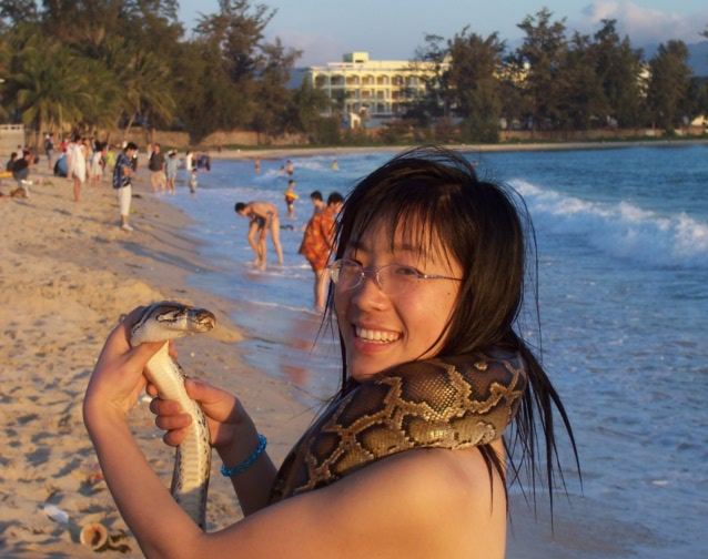 Picture: Guo Wei with a python, or possibly a young boa.  Sanya, Hainan Isnald, China 2005