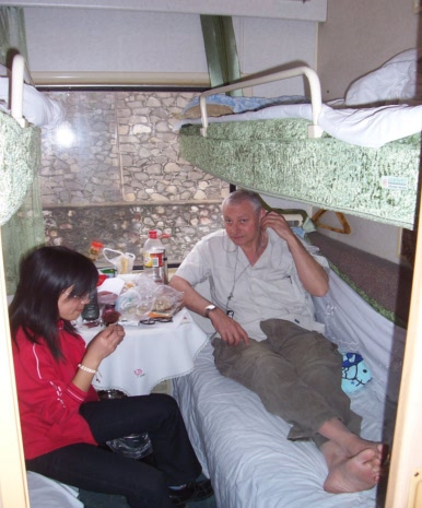 Picture:  Chinese lessons on the train with Ruth and Guo Wei to Guangzhou, China, 2005