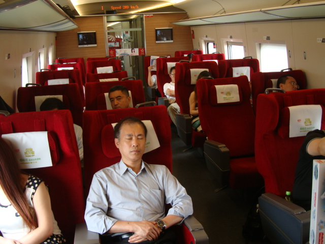 Picture: passengers sleep on board the Wuxi-Shanghai gao train.  China