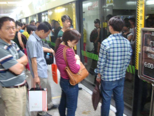 Picture: people unclear on the concept of not blocking the exiting passengers.  Shanghai, China