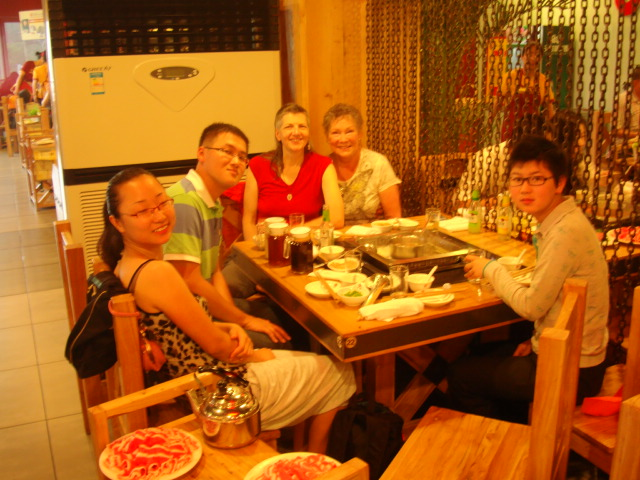 Picture:  Cath, George, Panda, at lunch in Wuxi, China