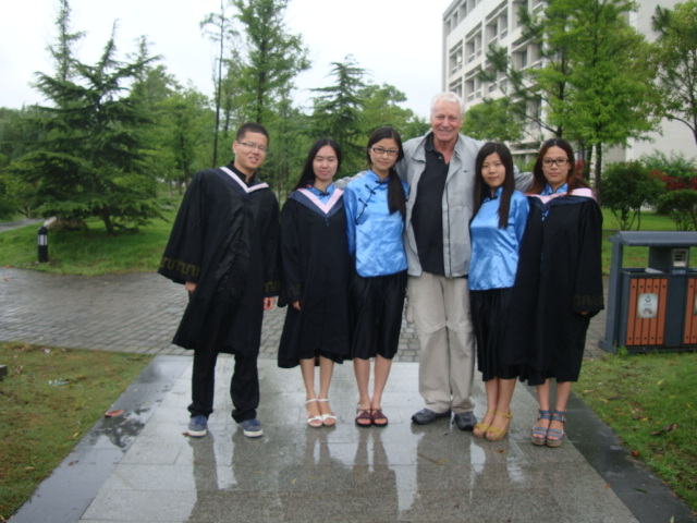 Picture:  Da Dawei with four of his former students. Juangnan University, Wuxi, China