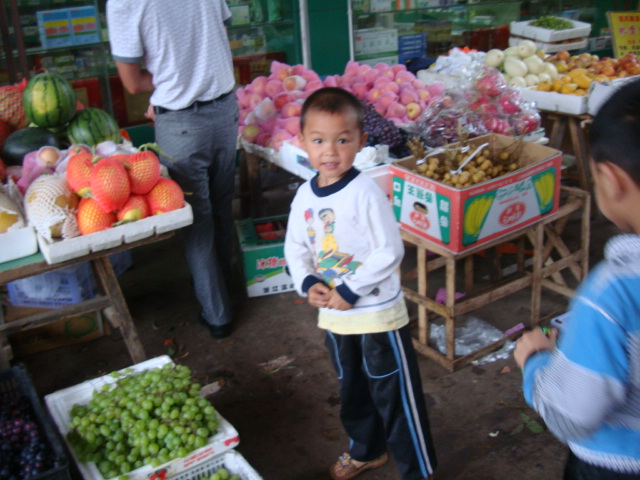 Picture: a boy marvels at the foreigners in the market at Xingan, China