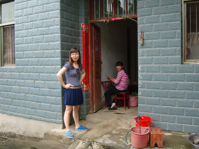 Picture:  Jenny at the door to her uncle's home in Shuibian, Jiangxi, China