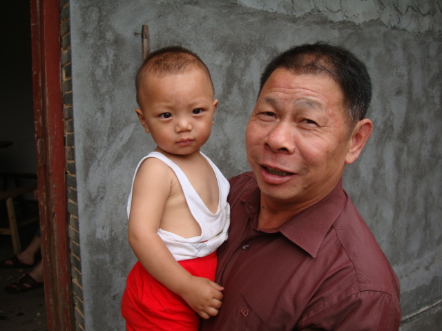 Picture:  Jenny's uncle and nephew, Shuibian, Jiangzi, China