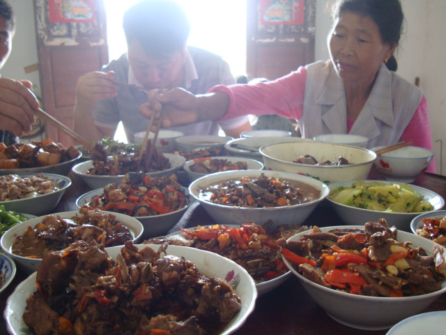 Picture:  Jenny's family at the festival feast.  Shuibian, Jiangxi, China