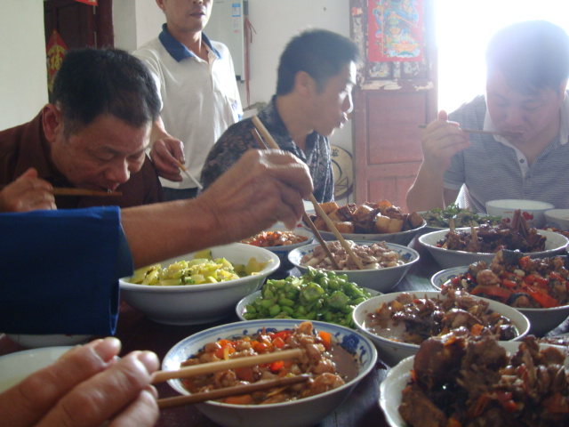 Picture:  the family enjoys a festival meal in Shuibian, Jiangxi, China
