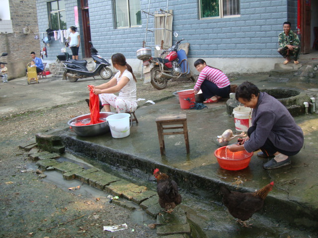 Picture:  Food preparation and laundry around the family well.  Shuibian, Jiangxi, China