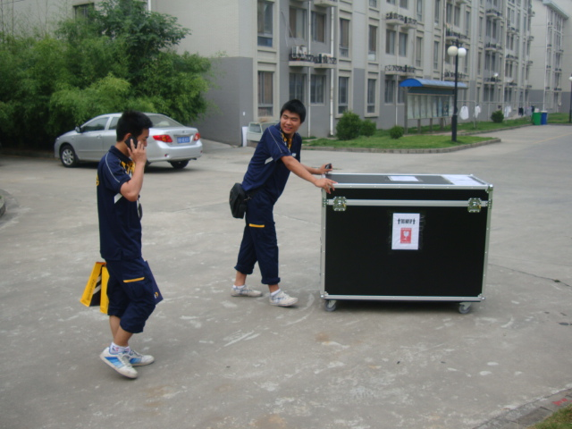 Picture:  Walking the big box to the little East gate.  Jiangnan University, Wuxi, China