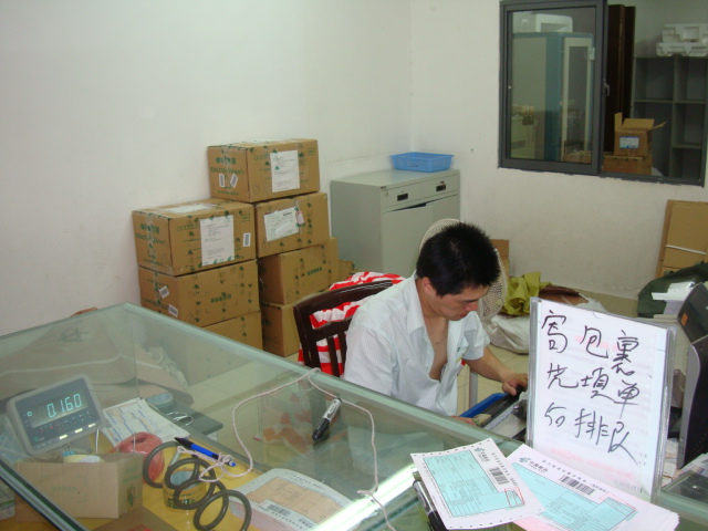 Picture:  Our seven boxes ready to float off to Canada in the campus post office.  jiangnan University, Wuxi, China