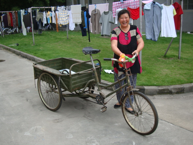 Picture:  Our cleaning lady and her inherited trike.  Jiangnan University, Wuxi, China
