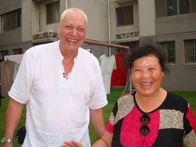 Picture:  David and our jovial cleaning lady.  Jiangnan University, Wuxi, China