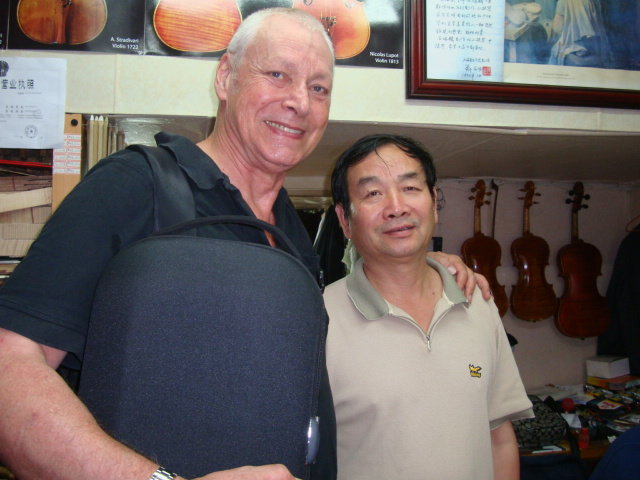Picture:  a final visit to the maker of my Shanghai violin.