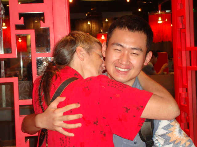 Picture:  Ruth hugs Frank Chen.  Zen Restaurant, Raffles Plaze, Shanghai, China
