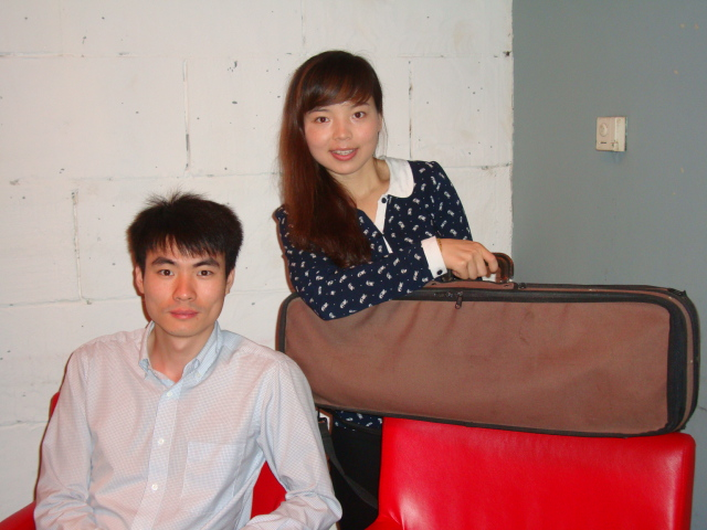 Picture:  Xiao Qiang and Jenny with my Tadioli violin.  Zen Restaurant, Raffles Plaze, Shanghai, China