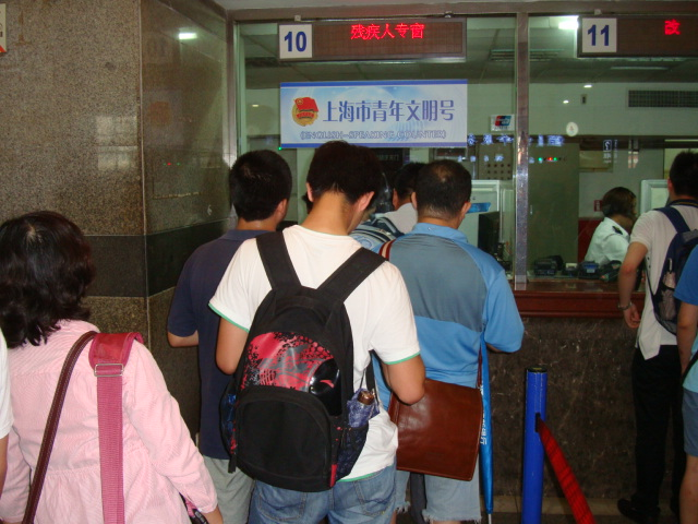 Picture:  Ticket lineup Shanghai railway station ticket office.  Shanghai, China