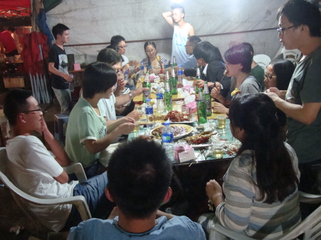 Picture:  Student celebrate the end of the term.  Shitang Cun barbecue, Wuxi, China