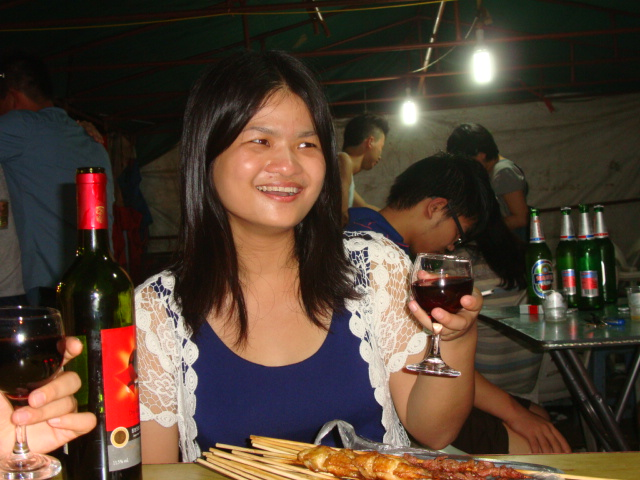 Picture:  Gloria at the street barbecue.  Shitang Cun, Wuxi, China
