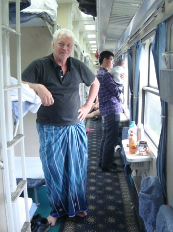 Picture: David in his longji, aboard the train for Shanghai.