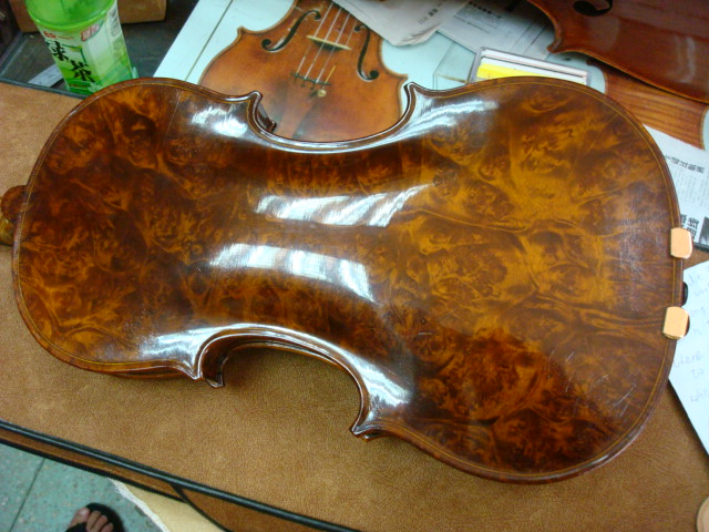 birds eye maple back of a hand made violin,  Shanghai,  China