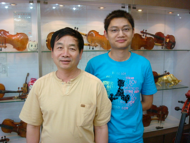 Master violin maker and son,  Shanghai
