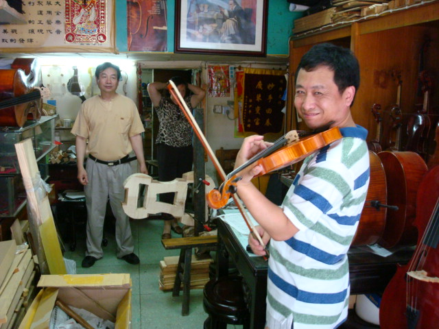 violin maker's shop,  Shanghai,  China